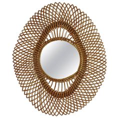 Superb Mid-Century Rattan Mirror from Marbella | From a unique collection of antique and modern sunburst mirrors at https://www.1stdibs.com/furniture/mirrors/sunburst-mirrors/