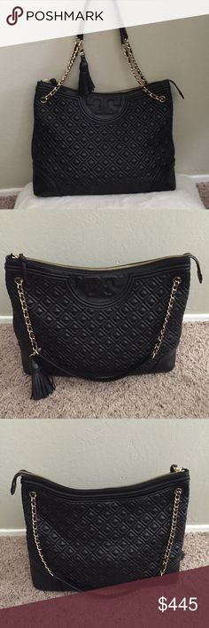 """Tory Burch Fleming Shoulder Bag Pre-loved. In great condition. Bottom has scratches. Back of strap has discoloration. Edges has scuffs. Please see pictures. I'll post more pics of the defects soon. 15 ¼""""W x 12""""H x 5""""D. (Interior capacity: large.) 9"""" strap drop; 16"""" shoulder strap drop. 1.4 lbs.  Top zip closure. Pull-through chain-and-leather handles. Exterior slip pocket. Interior zip, wall and smartphone pocket. Optional tassel. Logo-jacquard lining. Lambskin leather. Tory Burch Bags…"""
