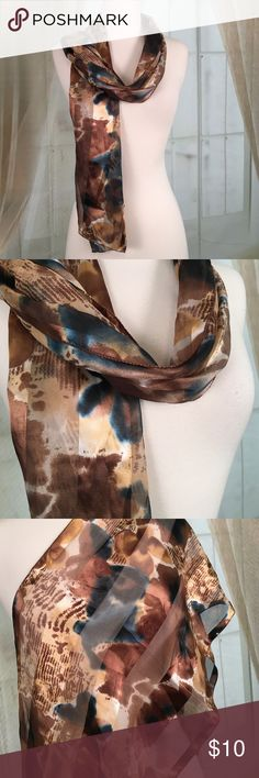 """Beautiful Brown Scarf Beautiful brown scarf. 100% polyester. Feels very silky.  Great condition. Measures 60"""" long by 13"""" wide.  Offers always welcome.  AS11 Accessories Scarves & Wraps"""