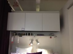 There is the storage above the bed. I love the cabinets, they are touch ones that open when you push on them.