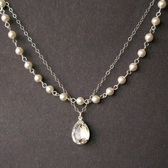 Crystal and Pearl Bridal Necklace Vintage Style by luxedeluxe, $78.00  It goes well with my ladies jewelry, but the price eh..