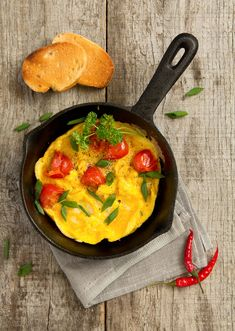 Scrambled eggs with grilled tomatoesby Lesya Dolyuk