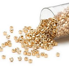 Seed bead, Delica®, glass, galvanized yellow gold, (DB410), #11 round. Sold per 7.5-gram pkg. - Fire Mountain Gems and Beads