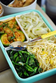 Korean vegetable side dishes (banchan) bento box - spicy zucchini, radish, spinach, soy bean sprouts