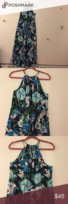 NWT Floral Halter Maxi Dress NWT Ann Taylor LOFT Floral Halter Maxi Dress. Elegant Maxi Dress with tie belt and slit on left side. Pairs perfectly with a cardigan or blazer for a night out! Halter ties at the back. Fabric is 100% polyester and soft! LOFT Dresses Maxi
