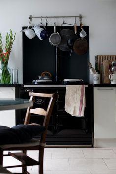Louisa-Grey-kitchen-black-AGA-white-cabinets-wood-counter, Remodelista