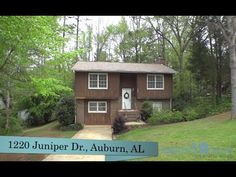 1220 Juniper Dr , Auburn, AL Character-filled, 4BR, 3BA split level home in established neighborhood! LR on upper level w/ vaulted tongue-&-groove ceiling, brick woodburning frpl., pre-engineered hardwoods installed in 2006, opens to dining area. Updated kitchen w/ granite counters, hardwoods, black GE Profile® appliances, white cabinetry. Spacious MBR w/ en suite bath. Gorgeous natural light throughout! New carpet! Lower level offers 2 add'l bedrms plus Den or 4th BR w/walk out access to…