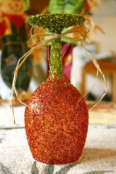 Wine Glass Glitter Pumpkins - on etsy, but probably easy to DIY... cute turned like this and put  candles on them for a very pretty table