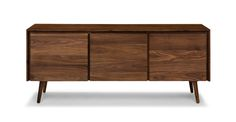 This mid-century modern sideboard is an elegant wood addition to any living space in need of a Danish modern touch. Store dinnerware in its three cabinets while displaying belongings (or a flatscreen) on its well-proportioned top. Mid Century Modern Sideboard, Mid Century Modern Furniture, Modern Credenza, Walnut Sideboard, Sideboard Buffet, Tv Credenza, Side Board, Farmhouse Style Kitchen, Modern Farmhouse Kitchens