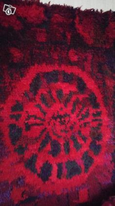 Karpalo ryijy--Cranberry rug on the wall