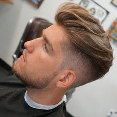 cutsbyerick undercut and loose natural hair on top