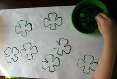 Printing shamrocks with a clover cookie cutter! ...then fingerpainting them!
