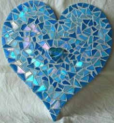 Mosaic hearts would be a good simple project to start with - although there's a lot of nipping tiles to finish up the curved edges.