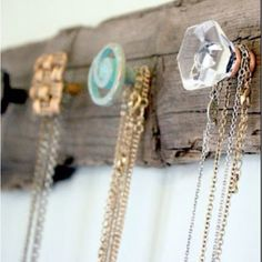 I think something simple like this will be the best bet for hanging my necklaces. May find a different base than the one shown, but love the knobs.
