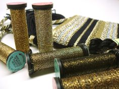Brown and gold shades of Kreinik metallic threads for needlework.
