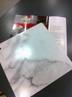 I actually love the retro look of faux marble formica. a great affordable option. This is a newer product that is a large scale laminate called by Formica. Large scale means the pattern repeats at 8 feet instead of the usual
