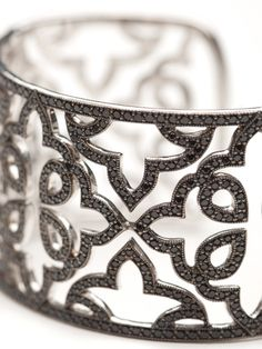 Jude Frances makes stunning bracelets and this bangle cuff is not exception.  The silver bracelet has a delicate lace design that is paved with black spinel for a chic look.  There is a hinge opening so it can easily slide onto any wrist.