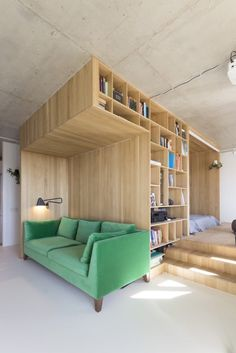Small apartment in Moscow with green sofa