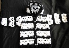 Oh no she didn't. Sorry couldn't help myself. Baby hoodie with a peek a boo openwork skull at the back of the hood. Sized for babies small u...