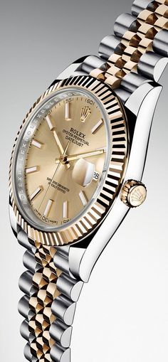 The Rolex Oyster Perpetual Datejust 41 in steel and yellow gold with a champagne dial and a five-piece link Jubilee bracelet. Check out this master piece and other cool watches for men awesome prices.#afflink