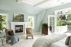 fireplace, balcony, wall color..ceiling structure adds a nice upward flow.
