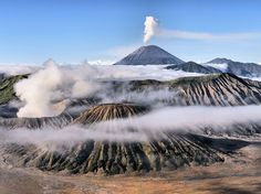 """Morning Java"" by Achmad Sumawijaya: Photographer Achmad Sumawijaya waited three hours to capture this picture of Mount Bromo (in foreground) and Mount Semeru (in background) on a misty morning in East Java, Indonesia. Some Indonesians believe that the volcanoes are portals to a subterranean world."