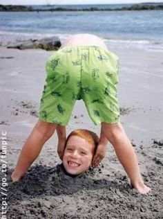 hahahahaha (if you don't get it, one little boy is leaning over and not showing his face while they buried another little boy in the sand and just left his head out so it would look like one little boy was picking up his head) :) :)