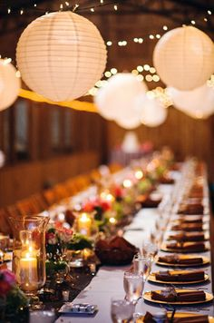 white lanterns over family style tables