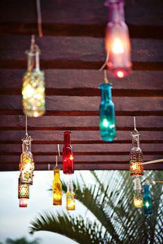 Boho outdoor lighting idea. Lights in bottles.