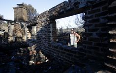 Poinsettia fire  Gilbert Cope surveys a destroyed home in the 1700 block of Skimmer Court in Carlsbad.  http://www.latimes.com/local/lanow/la-me-san-diego-brush-fire-pg-053-photo.html