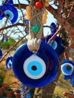 created with macramé as a malocchio talisman Text Symbols, Devil Eye, Turkish Eye, Greek Evil Eye, Look Into My Eyes, Prayer Flags, Evil Eye Jewelry, Evil Spirits, Lucky Charm