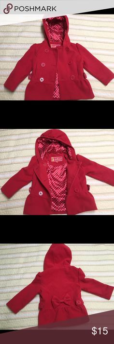 Red winter toddler girl's coat. Toddler girl's winter coat in size 3T. With interior polka dot design. Cute bow tie in the back of the coat. In good condition. No zip only buttons. Dollhouse Jackets & Coats Pea Coats