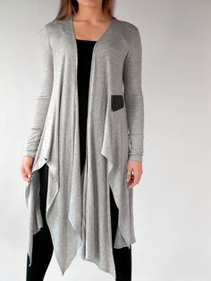 Draped light gray cardigan. Ultra soft rayon jersey with stretch. Perfect cover-up over fitness, dance, yoga and pilates wear. Great over leggings or jeans. By Erin Draper.