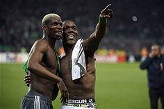 TOPSHOT - Manchester United's French midfielder Paul Pogba (L) and his brother Saint-Etienne's Guinean defender Florentin Pogba (R) greet their family in the tribune at the end of the UEFA Europa League football match between AS Saint-Etienne and Manchester United on February 22, 2017, at the Geoffroy Guichard stadium in Saint-Etienne, central France. / AFP / PHILIPPE
