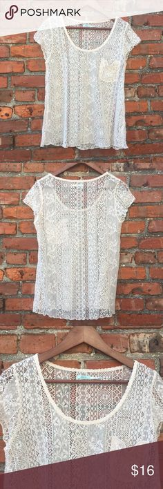 Urban Outfitter Lace See Through Top Lace top. Good condition. Has one front pocket on left side. Short sleeve. Size Medium. Pit to Pit 17in. Length 22in Urban Outfitters Tops