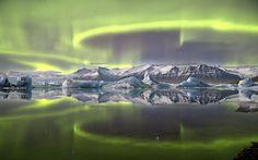 the Northern Lights reflected in the Jökulsarlon lagoon of the Vatnajökull National Park in Iceland.