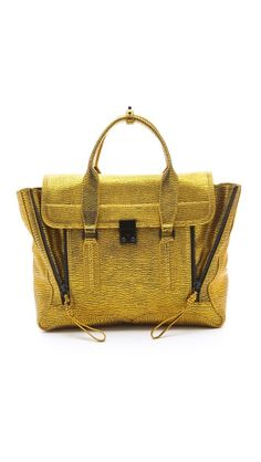 i have a love/hate relationship with limited edition stuff. like, i love it when i have one, but i hate it when i can't get it. like this 3.1 Phillip Lim Pashli Satchel... this one. this color. this acid yellow gold thing. i'm coveting this in the worst way possible. <3