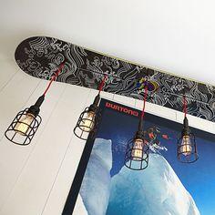 Snowboard Light. that is just fricken awesome! would be cool to have this for the lighting in a garage:). Or in the mud room
