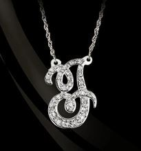 """Stunning single initial monogram necklace in diamonds, designed by Jane Basch, measures 3/4"""". It is created in Sterling Silver with your single initial in script."""