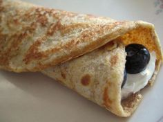 """Whole wheat crepes??? Seriously, we made these tonight and they were amazing. Tender with a little stretch, and still whole grain. Don't want to lose this recipe! Mine turned out a lot more """"crepe""""-like than this picture, nice and thin."""