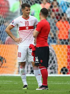 Granit Xhaka of Switzerland and Taulant Xhaka of Albania swap shirts after the UEFA EURO 2016 Group A match between Albania and Switzerland at Stade Bollaert-Delelis on June 2016 in Lens, France. Uefa European Championship, European Championships, Albania Football, Granit Xhaka, Uefa Euro 2016, Switzerland, Running, Lens, France