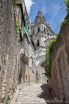 Street scene in a historic alley in Blois France. Blois Cathedral in ...