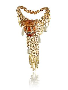 Chopard's Cougar necklace, from the Animal World collection, features white and coloured diamonds, fire opals and four pear-shaped moonstones set in yellow and white gold.