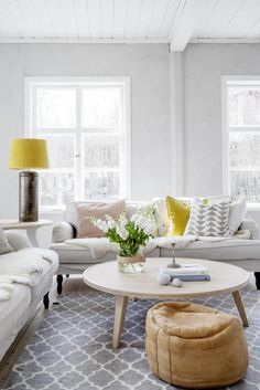 Zesty yellow in the sitting room of the dreamy, rural Swedish summer cottage of Erica Franzén.