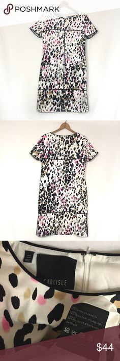 """CARLISLE $398 spotted stretch cotton short sleeve Excellent Condition!   Rear zip.  Cotton, spandex.  Fully lined.  Front pockets.  Light shoulder padding.  4"""" side slits.   bust 37"""" waist 35"""" hip 39"""" length 37"""" Carlisle  Dresses Midi"""