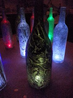 Wedding table centerpieces, table candles, wine bottle lanterns