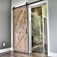 Gray sliding barn door. Arrow Kingship Hardware with Double Z barn door.