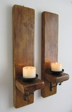 Pair of reclaimed plank wood wall sconce candle holders with antique cast iron brackets Pair of rustic wall sconces with removable black metal candle holders. Made from reclaimed thick planks wit Rustic Wall Lighting, Rustic Wall Sconces, Candle Wall Sconces, Rustic Walls, Rustic Wood, Barn Wood, Wood Sconce, Metal Barn, Rustic Barn