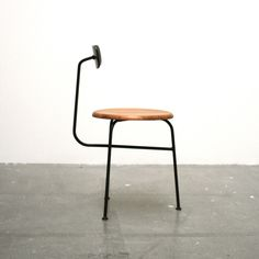 like a 3-legged stool, but with a small back rest-  Afteroom Chair by Afteroom Studio
