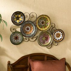 Bring your wall to life with this exquisite, Forli Scattered 6-piece Italian Plates Wall Art Set. The six bowls are a varying arrangement of flowers in shades of white, yellow, orange, green, pink and black, green, blue, and brown backgrounds.